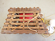 Rock lobster pot with ropes and floats