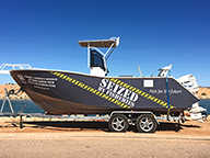 Seized boat on display at a popular boat ramp