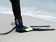 Scuba divers ankle showing shark shield device